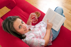 Young woman relaxing and reading a book Royalty Free Stock Photos