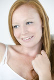 Young woman relaxing with red hair Stock Photo