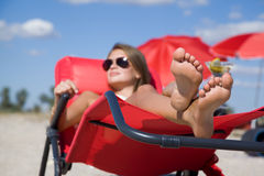 Young woman relaxing at the resort. Lying on a lounger Royalty Free Stock Photo