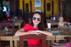Young woman relaxing at resort restaurant Royalty Free Stock Photos