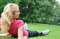 Young woman relaxing after roller skating Stock Image