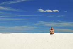 Young Woman Relaxing On Sand Dunes Royalty Free Stock Photography