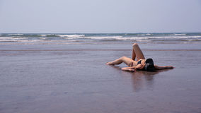 Young woman relaxing sandy beach Royalty Free Stock Image