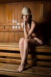 Young woman relaxing in a sauna Stock Photography