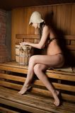 Young woman relaxing in a sauna Royalty Free Stock Photo