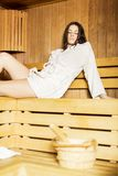 Young woman relaxing in the sauna Royalty Free Stock Photo