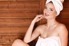 Young woman relaxing in a sauna Royalty Free Stock Images