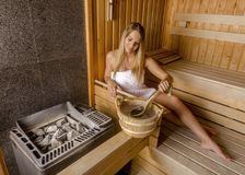 Young woman relaxing in sauna and enjoy the hot air. Royalty Free Stock Photography
