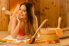Young woman relaxing in sauna. Spa wellbeing. Stock Image