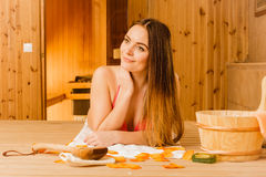 Young woman relaxing in sauna. Spa wellbeing. Stock Images