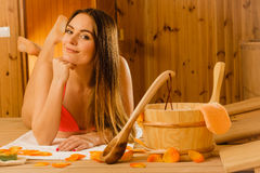 Young woman relaxing in sauna. Spa wellbeing. Stock Photography
