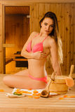 Young woman relaxing in sauna. Spa wellbeing. Royalty Free Stock Photos