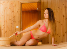 Young woman relaxing in sauna. Spa wellbeing. Royalty Free Stock Photo