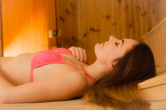 Young woman relaxing in sauna. Spa wellbeing Royalty Free Stock Image