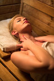 Young woman relaxing in a sauna Stock Photo