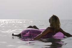 Young woman relaxing in the sea. Royalty Free Stock Photos