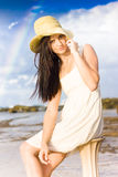 Young Woman Relaxing By The Sea Royalty Free Stock Photo