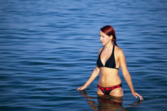 Young woman relaxing in sea Stock Image