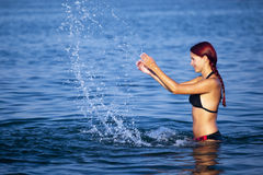 Young woman relaxing in sea Stock Images