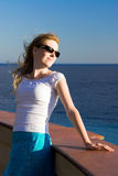 Young woman relaxing on sea coast Royalty Free Stock Photo