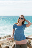 Young woman relaxing at the sea Royalty Free Stock Photos
