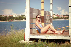 Young Woman Relaxing by the Sea. Toned Photo. Royalty Free Stock Image