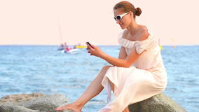 Young Woman Relaxing at Seaside stock video footage