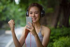 Young woman relaxing and singing while listening music with earp Royalty Free Stock Images
