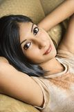 Young woman relaxing on sofa. Stock Photos