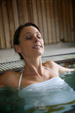 Young woman relaxing in spa center Royalty Free Stock Photo