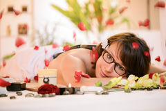 Young woman relaxing at the spa center Stock Photos