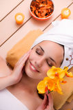 The young woman relaxing in spa in health concept Stock Photo