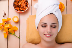 The young woman relaxing in spa in health concept Stock Photography
