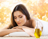 Young woman relaxing on a spa massage Royalty Free Stock Image