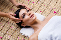 Young woman relaxing on a spa massage procedure Royalty Free Stock Photography