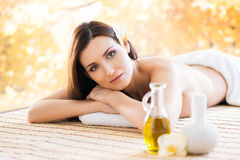 Young woman relaxing on a spa massage procedure Stock Image