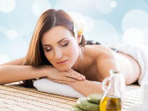 Young woman relaxing on a spa massage procedure Stock Images