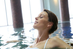 Young woman relaxing in spa pool Royalty Free Stock Photo