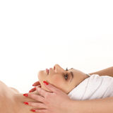 A young woman relaxing on a spa procedure Stock Photo