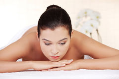 Young woman relaxing in spa saloon Stock Image