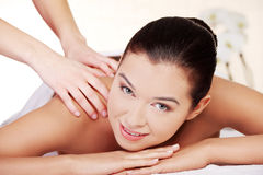 Young woman relaxing in spa saloon Stock Photography