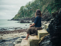 Young woman relaxing on stairs in nature by sea Royalty Free Stock Photo