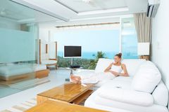 Young woman relaxing in a stylish lounge Royalty Free Stock Images