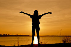 Young woman relaxing in summer sunset sky Stock Images
