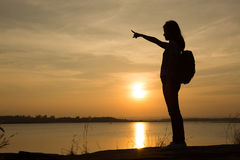 Young woman relaxing in summer sunset sky Stock Photography