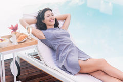 Young woman relaxing on a sun lounger Royalty Free Stock Image