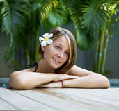 Young woman relaxing in a swimming pool Stock Images