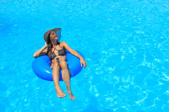 Young woman relaxing at the swimming pool Stock Photo