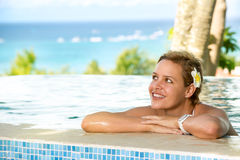 Young woman relaxing in the swimming pool Royalty Free Stock Images