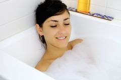 Young woman relaxing taking a bath Stock Photography